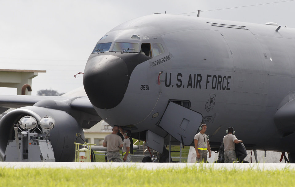In this Aug. 14, 2012 photo, ground crew members work on a U.S. Air Force KC-135 Stratotanker at Kadena Air Base on Japan\'s southwestern island of Okinawa. The most recent of the KC-135 refueling tankers currently in service started flying in 1964. For decades, the U.S. Air Force has grown accustomed to such superlatives as unrivaled and unbeatable. Now some of its key aircraft are being described with terms like decrepit. (AP Photo/Greg Baker)