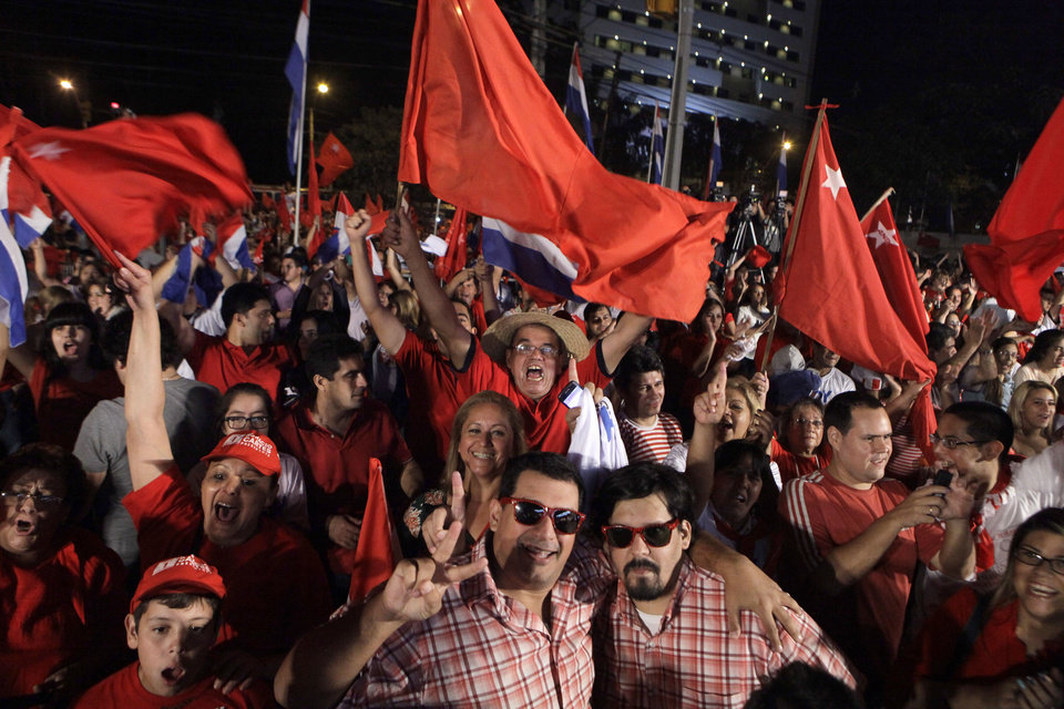 Photo - Colorado Party supporters celebrate the victory of their candidate in presidential election  in Asuncion, Paraguay, Sunday, April 21, 2013.  Colorado Party candidate Horacio Cartes won a five-year term with 46 percent of the vote over 37 percent for Efrain Alegre of the Radical Liberal party, the Electoral Court announced after most votes were counted. Five other candidates trailed far behind.(AP Photo/Jorge Saenz)