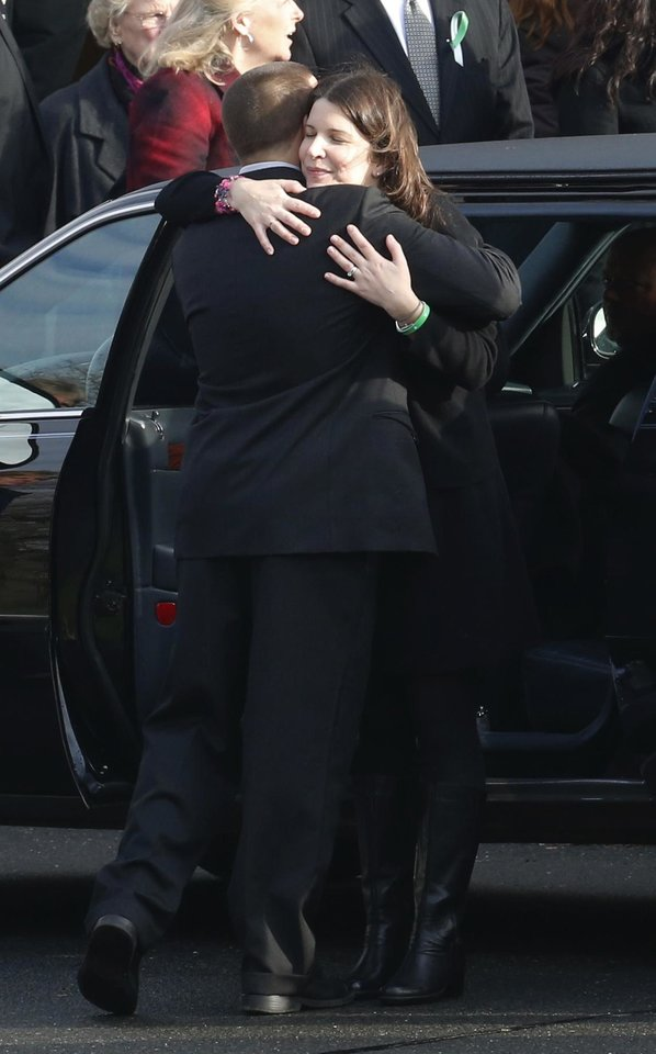 A man, left, hugs Krista Rekos following funeral services for her daughter, Jessica Rekos, at St. Rose of Lima Roman Catholic Church, Tuesday, Dec. 18, 2012, in Newtown, Conn. Jessica Rekos, 6, was killed when Adam Lanza walked into Sandy Hook Elementary School in Newtown, Conn., Dec. 14, and opened fire, killing 26 people, including 20 children, before killing himself. (AP Photo/Julio Cortez) ORG XMIT: CTJC124