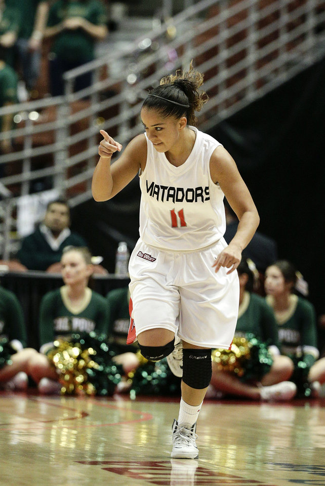 Photo - Cal State Northridge's Cinnamon Lister points to a teammate after making a three point basket against Cal Poly during the first half of an NCAA college basketball game in the final of the Big West Conference tournament, on Saturday, March 15, 2014, in Anaheim, Calif. (AP Photo/Jae C. Hong)