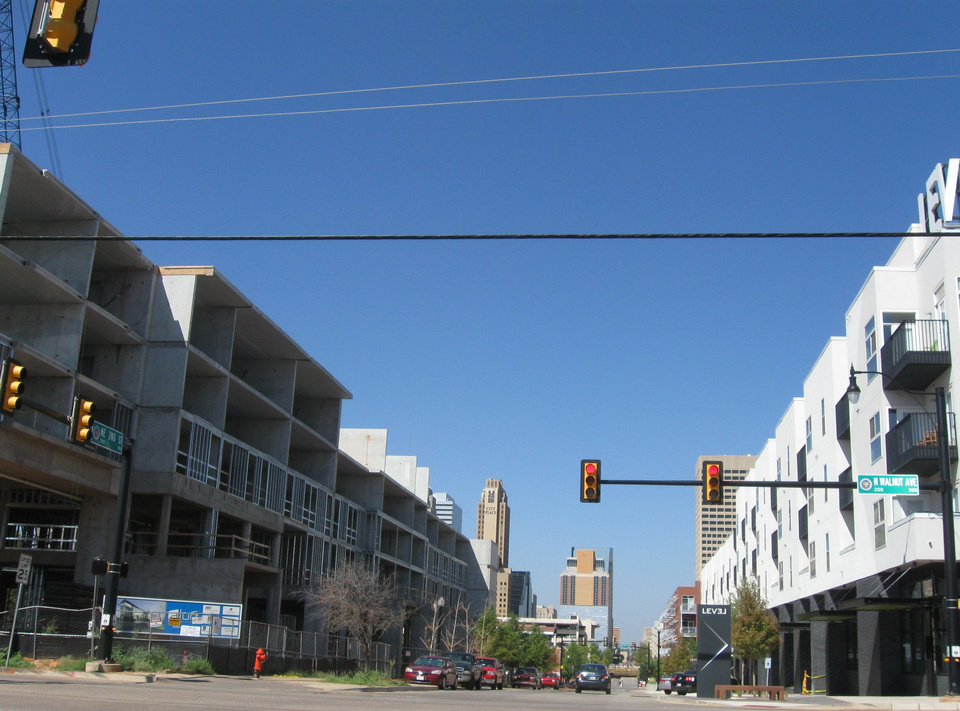 The Aloft Hotel can be seen going up on the south side of NE 2 at Walnut Avenue, while the recently opened Level Urban Apartments is across the street. Photos by Steve Lackmeyer, The Oklahoman