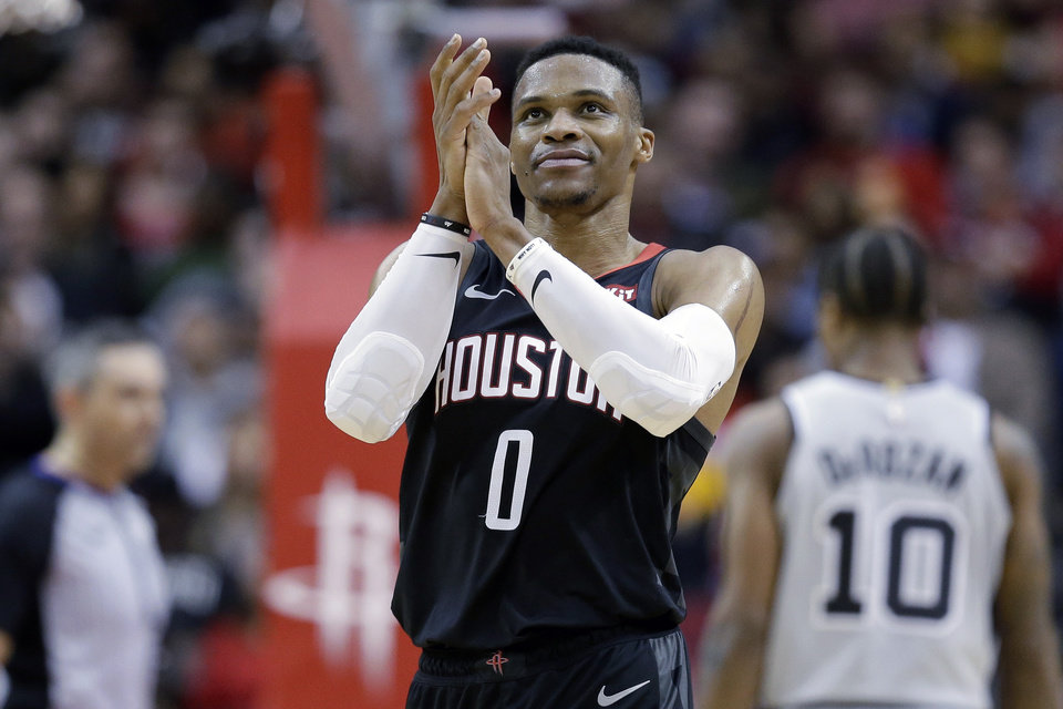 Photo - Houston Rockets guard Russell Westbrook (0) claps during the second half of an NBA basketball game against the San Antonio Spurs, Monday, Dec. 16, 2019, in Houston. (AP Photo/Eric Christian Smith)