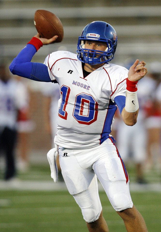 Corey Reeves (10) of Moore passes the ball during a high school football game between Edmond Memorial and Moore at Wantland Stadium in Edmond, Okla., Thursday, Sept. 29, 2011. Photo by Nate Billings, The Oklahoman
