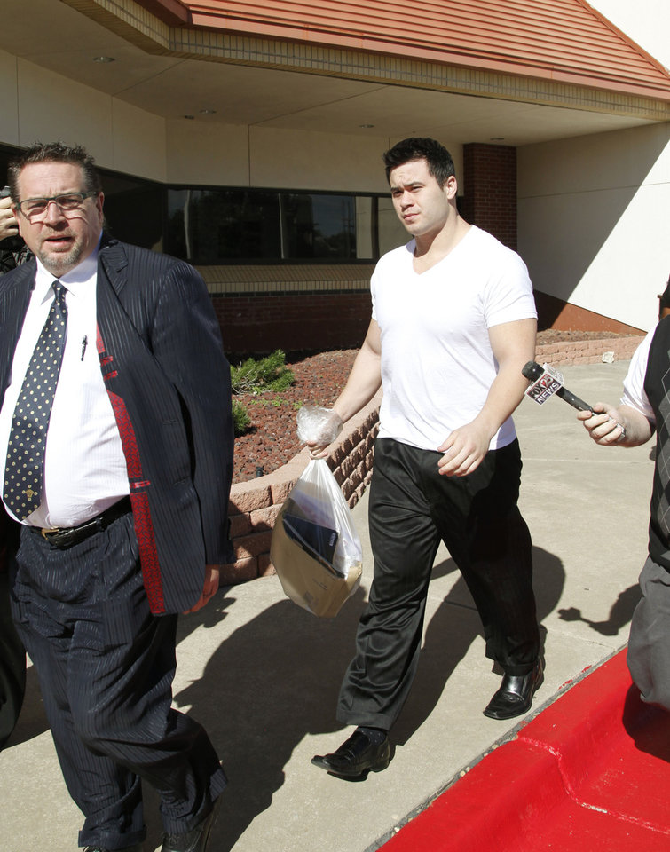 Photo - Daniel Holtzclaw, an Oklahoma City Police Officer accused Of Sexually Assaulting At Least 6 Women While On Duty, walks out on bond from the Oklahoma County Courthouse in Oklahoma City, OK, Thursday, October 16, 2014,  Photo by Paul Hellstern, The Oklahoman