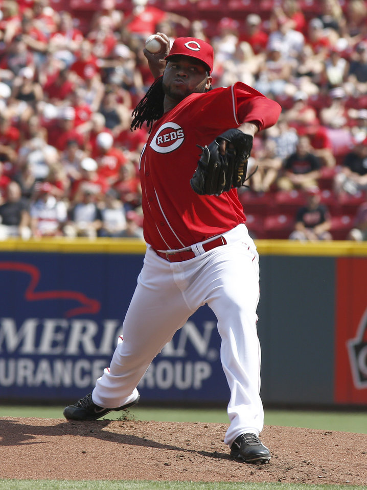 Photo - Cincinnati Reds starting pitcher Johnny Cueto throws against the Washington Nationals in the first inning of a baseball game on Saturday, July 26, 2014, in Cincinnati. (AP Photo/David Kohl)
