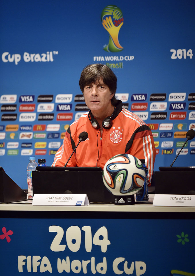 Photo - Germany's head coach Joachim Loew talks to the media during a press conference one day before the World Cup quarterfinal soccer match between Germany and France at the Maracana Stadium in Rio de Janeiro, Brazil, Thursday, July 3, 2014. (AP Photo/Martin Meissner)