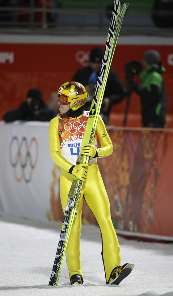 Photo - Japan's Noriaki Kasai checks the scoreboard after his first attempt during the ski jumping large hill final at the 2014 Winter Olympics, Saturday, Feb. 15, 2014, in Krasnaya Polyana, Russia. (AP Photo/Gregorio Borgia)