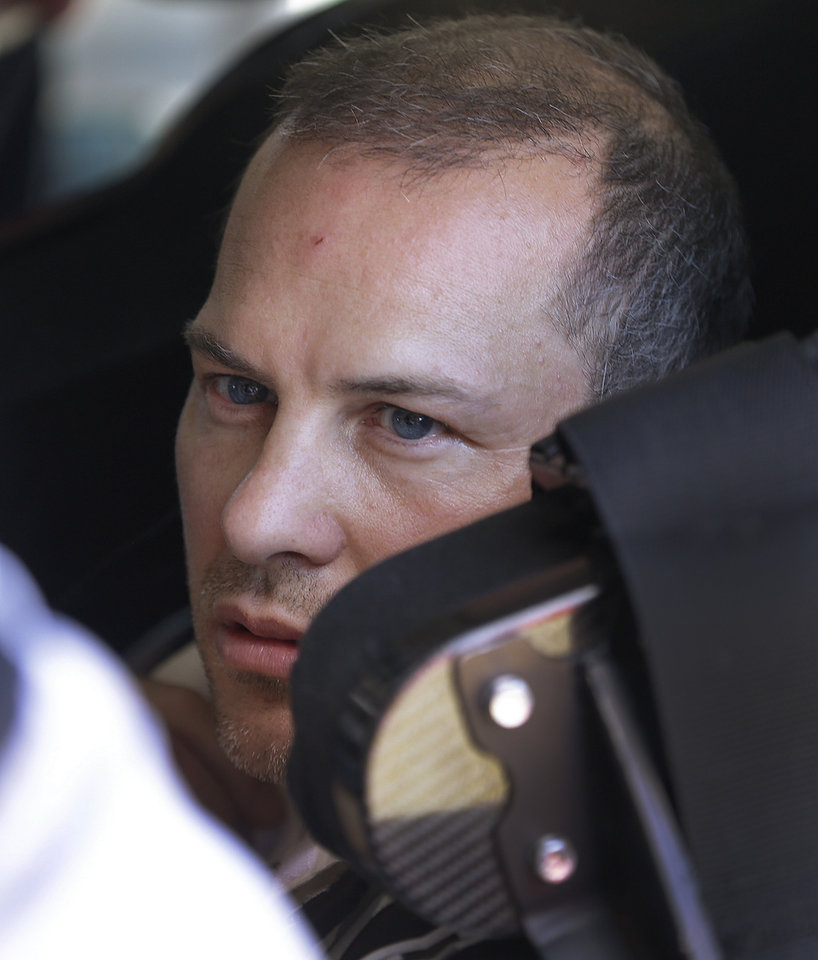 Photo - Driver Jacques Villeneuve, of Canada, prepares to take practice laps for the NASCAR Sprint Cup Series auto race Friday, June 21, 2013, in Sonoma, Calif. (AP Photo/Ben Margot)