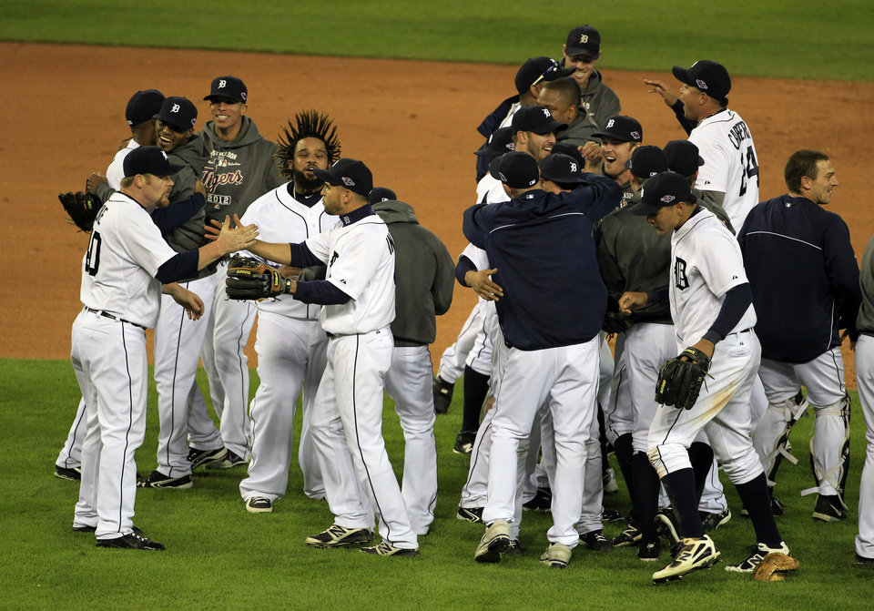 Photo -   The Detroit Tigers celebrate after winning Game 4 of the American League championship series 8-1, against the New York Yankees, Thursday, Oct. 18, 2012, in Detroit. The Tigers move on to the World Series. (AP Photo/Carlos Osorio)