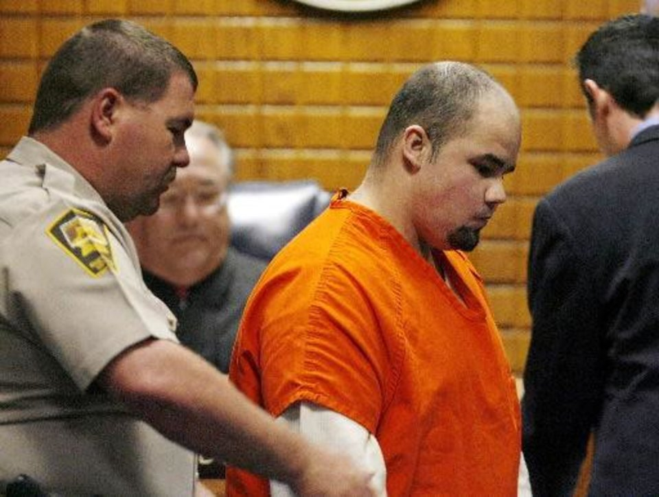 Photo - Murder defendant Josh Durcho appears today before Judge Edward Cunningham in a Canadian County courtroom to be formally arraigned in the deaths of an El Reno woman and her four children last January. Photo by Jim Beckel