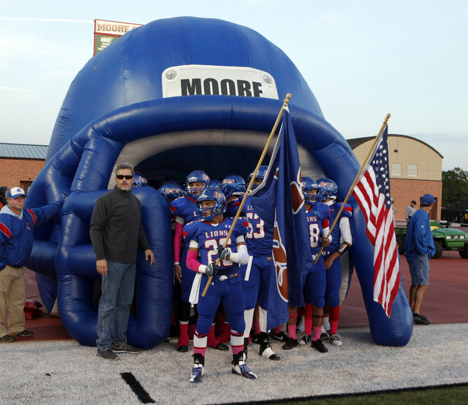 Photo - Moore Lions players prepare to take the field against the Lawton Eisenhower Eagles in a high school football game on Friday, Oct. 5, 2012, in Moore, Okla.  Photo by Steve Sisney, The Oklahoman