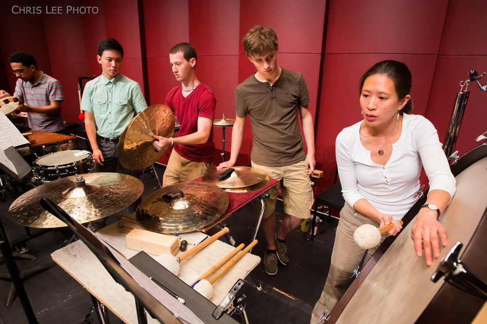 Photo - Cynthia Yeh, right, works with National Youth Orchestra percussionists, from left, Eric Goldberg, David Yoon, Micheal Barnes and Karl Ronneburg.   Photo by Chris Lee  Chris Lee