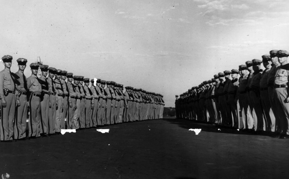 Photo - Above: The first group of Oklahoma Highway Patrol troopers stand in rows at the state Capitol on July 14, 1937, less than three months after the agency was created.  OKLAHOMAN  ARCHIVES PHOTO