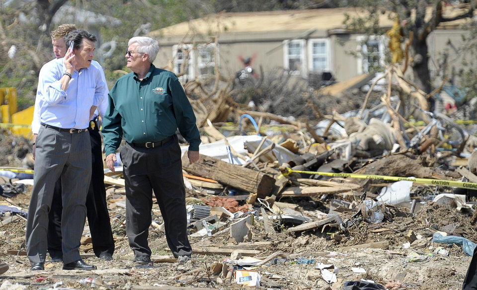 Photo - Texas Governor Rick Perry, left, and Wayne McKethan, Granbury City Manager, tour storm-damaged areas in Granbury, Texas, on Friday May 17, 2013. On Wednesday, powerful storms produced 16 tornadoes in the area that left six dead. (AP Photo/The Fort Worth Star-Telegram, Max Faulkner)  MAGS OUT; (FORT WORTH WEEKLY, 360 WEST); INTERNET OUT