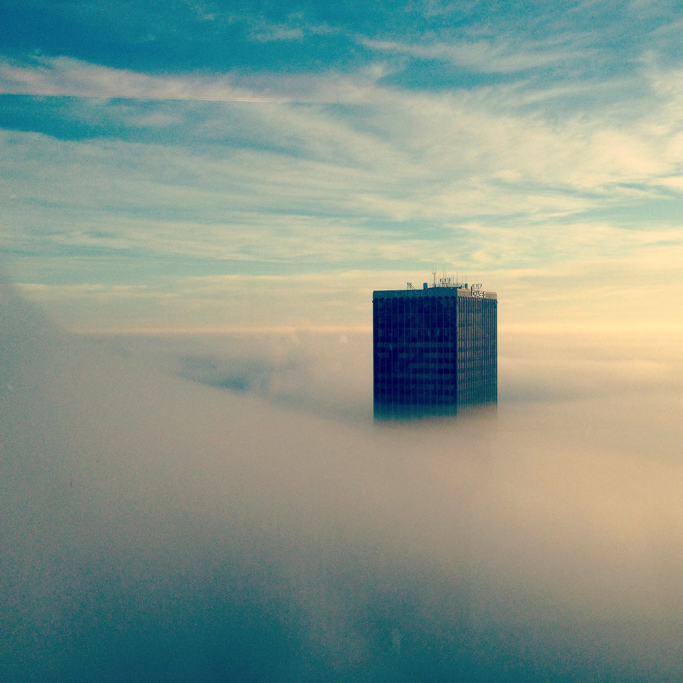 Photo - Ground fog covers downtown Oklahoma City, surrounding the Chase Tower Monday morning, December 2, 2013. Photo by Brett Mendenhall.
