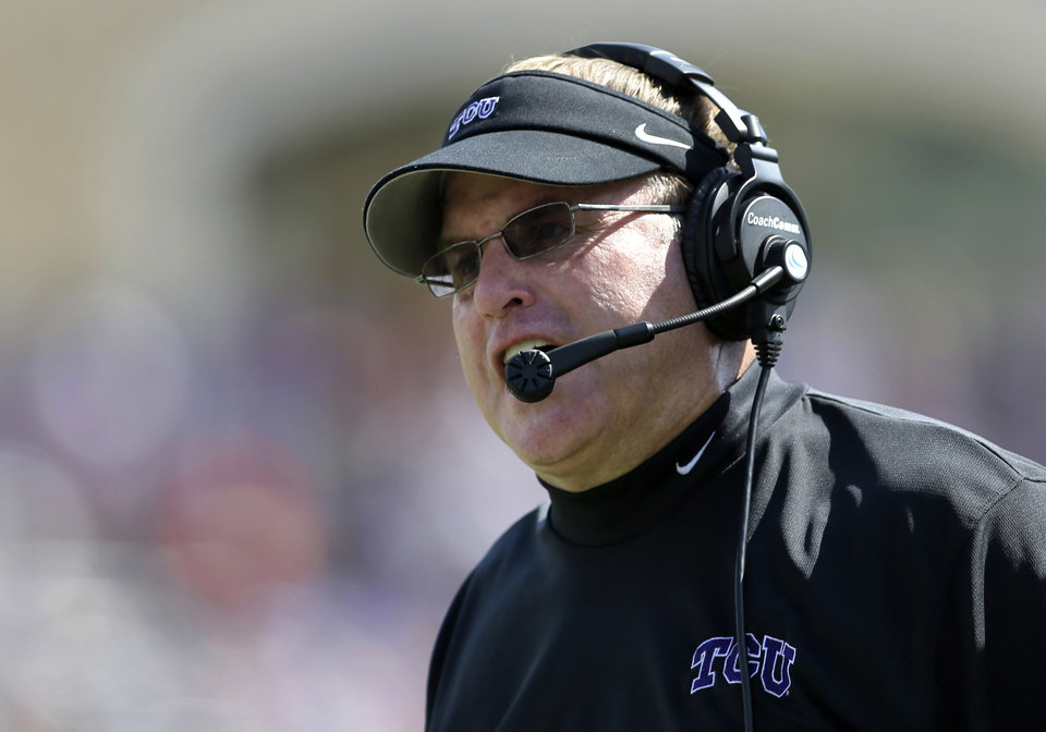 Photo - FILE - In this Oct. 12, 2013, file photo, TCU head coach Gary Patterson instructs his  team from the sideline in the second half of an NCAA college football game against Kansas in Fort Worth, Texas.  Patterson is coming off his second losing season in 13 seasons as TCU's head coach. (AP Photo/Tony Gutierrez, file)