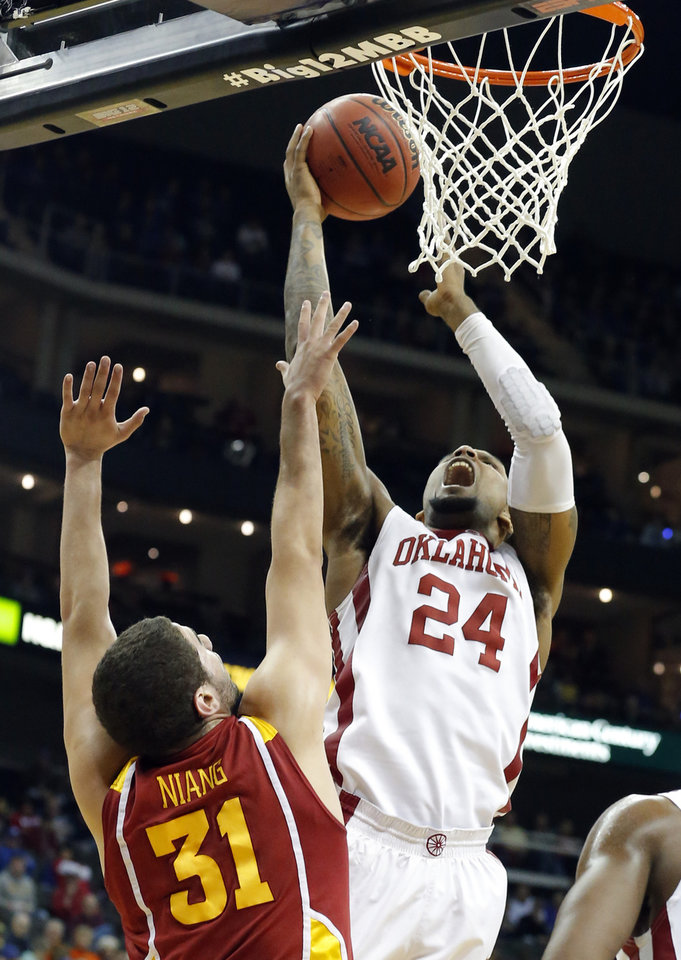 Photo - Oklahoma's Romero Osby shoots over Iowa State's George Niang  during the Phillips 66 Bug 12 Men's basketball championship tournament game between the University of Oklahoma and Iowa State at the Sprint Center in Kansas City, Thursday, March 14, 2013. Photo by Sarah Phipps, The Oklahoman