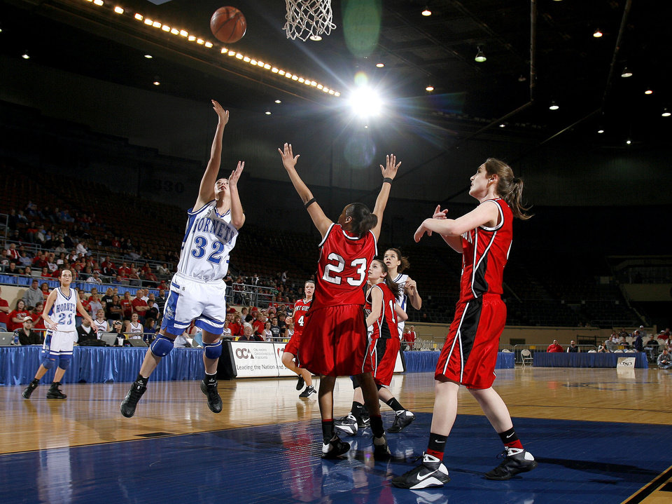 Photo - Vinita's Caitlyn Spurgeon (32) shoots in front of a host of Ft. Gibson defenders during girls 4A semifinal between Fort Gibson and Vinita at the State Fair Arena, Friday, March 13, 2009, in Oklahoma City. PHOTO BY SARAH PHIPPS, THE OKLAHOMAN