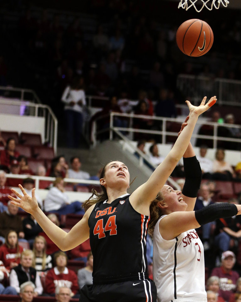 Photo - Oregon State's Ruth Hamblin (44) lays up a shot over Stanford's Mikaela Ruef during the first half of an NCAA college basketball game Sunday, Jan. 5, 2014, in Stanford, Calif. (AP Photo/Ben Margot)