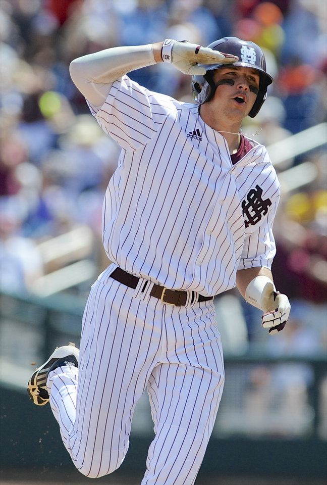 Photo - Mississippi State's Hunter Renfroe salutes as he rounds the bases after hitting a three-run home run against Oregon State in the fifth inning of an NCAA College World Series baseball game in Omaha, Neb., Friday, June 21, 2013. (AP Photo/Eric Francis)