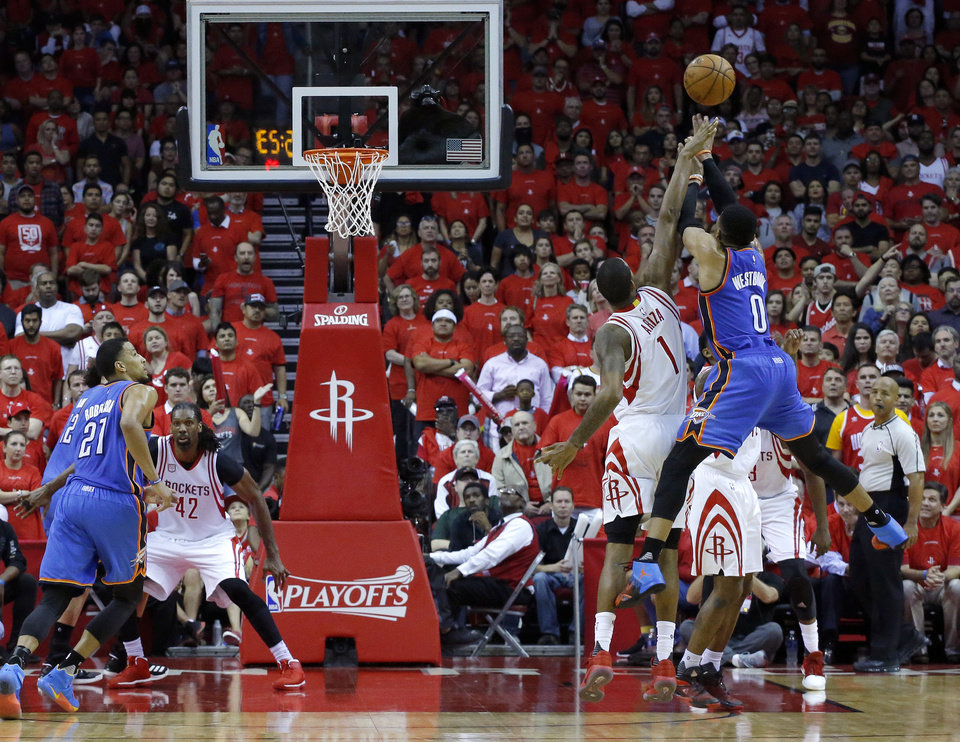 Photo - Oklahoma City's Russell Westbrook (0) shoots over Houston's Trevor Ariza (1)  in the fourth quarter during Game 5 in the first round of the NBA playoffs between the Oklahoma City Thunder and the Houston Rockets in Houston, Texas,  Tuesday, April 25, 2017.  Houston won 105-99. Photo by Sarah Phipps, The Oklahoman