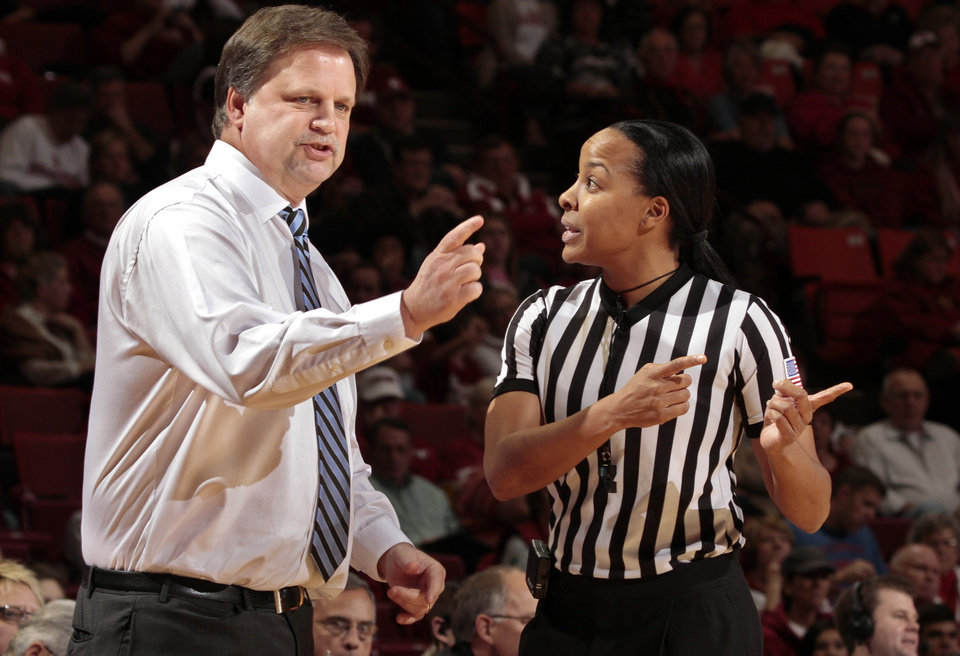 Photo - West Virginia Mountaineers head coach Mike Carey talks with a referee as the University of Oklahoma Sooners (OU) play the West Virginia Mountaineers in NCAA, women's college basketball at The Lloyd Noble Center on Wednesday, Jan. 2, 2013  in Norman, Okla. Photo by Steve Sisney, The Oklahoman