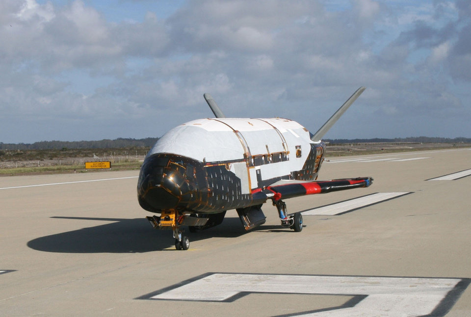 Photo - This March 30, 2010 photo made available by the U.S. Air Force via NASA shows the X-37B Orbital Test Vehicle during testing at the Astrotech facility in Titusville, Fla. On Tuesday, Dec. 11, 2012, the Air Force launched the top-secret, unmanned mini-space shuttle from Cape Canaveral, Fla. (AP Photo/U.S. Air Force via NASA)