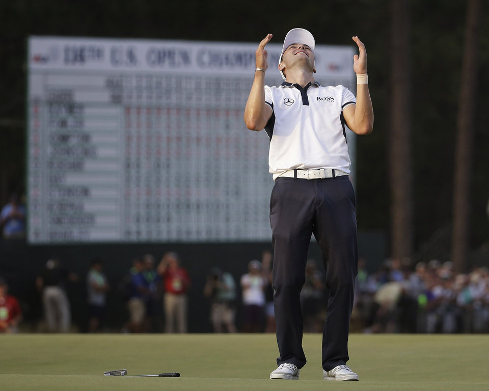 Photo - Martin Kaymer, of Germany celebrates after winning the U.S. Open golf tournament in Pinehurst, N.C., Sunday, June 15, 2014.  (AP Photo/David Goldman)