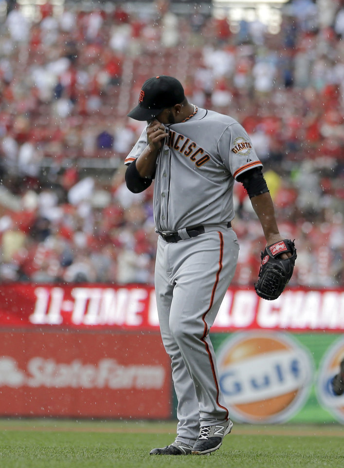 Photo - San Francisco Giants starting pitcher Yusmeiro Petit walks off the field at the start of a rain delay during the fifth inning of a baseball game against the St. Louis Cardinals Saturday, May 31, 2014, in St. Louis. (AP Photo/Jeff Roberson)