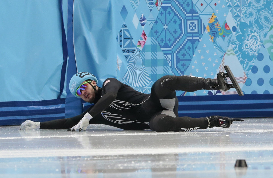 Photo - Eduardo Alvarez of the United States crashes out in a men's 500m short track speedskating heat at the Iceberg Skating Palace during the 2014 Winter Olympics, Tuesday, Feb. 18, 2014, in Sochi, Russia. (AP Photo/Ivan Sekretarev)