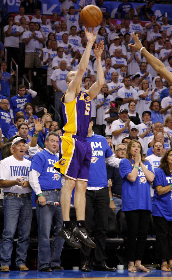 Photo - Los Angeles' Steve Blake (5) misses the last shot during Game 2 in the second round of the NBA playoffs between the Oklahoma City Thunder and L.A. Lakers at Chesapeake Energy Arena in Oklahoma City, Wednesday, May 16, 2012.  Oklahoma City won 77-75. Photo by Bryan Terry, The Oklahoman