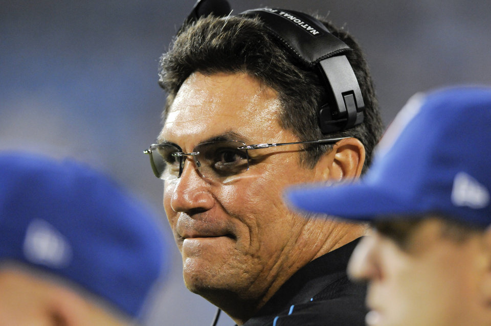 Photo -   FILE - This Aug. 11, 2012 file photo shows Carolina Panthers head coach Ron Rivera watches from the sidelines during an NFL preseason football game against the Houston Texans in Charlotte, N.C. Following the firing of general manager Marty Hurney on Monday, Oct. 22, 2012, Rivera could be beginning to feel the heat. (AP Photo/Mike McCarn, File)
