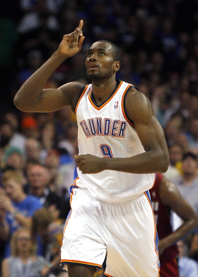 Photo - Oklahoma City's Serge Ibaka (9) celebrates during the NBA basketball game between the Miami Heat and the Oklahoma City Thunder at Chesapeake Energy Arena in Oklahoma City, Sunday, March 25, 2012. Photo by Sarah Phipps The Oklahoman