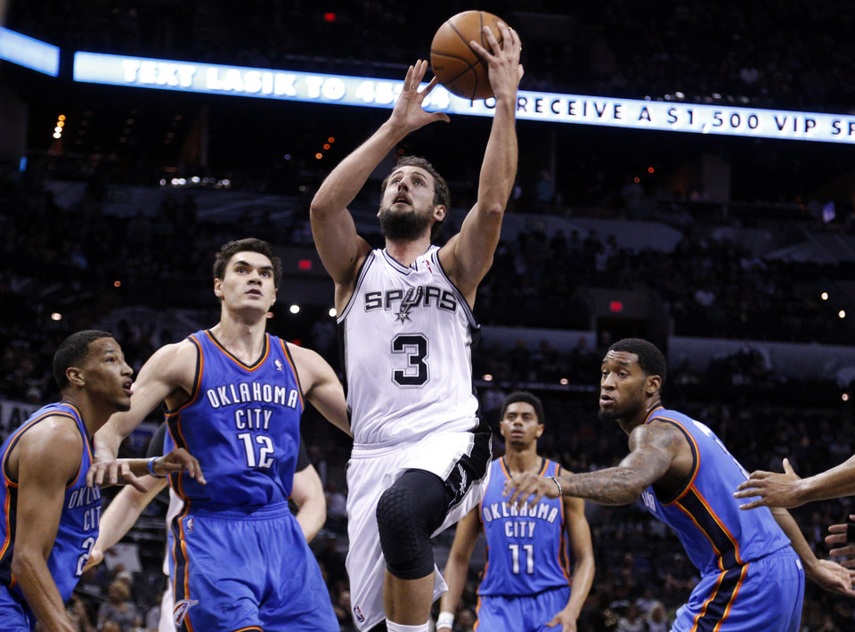 Photo - Marco Belinelli (3) shoot a lay up during Game 2 of the Western Conference Finals in the NBA playoffs between the Oklahoma City Thunder and the San Antonio Spurs at the AT&T Center in San Antonio, Wednesday, May 21, 2014. Photo by Sarah Phipps