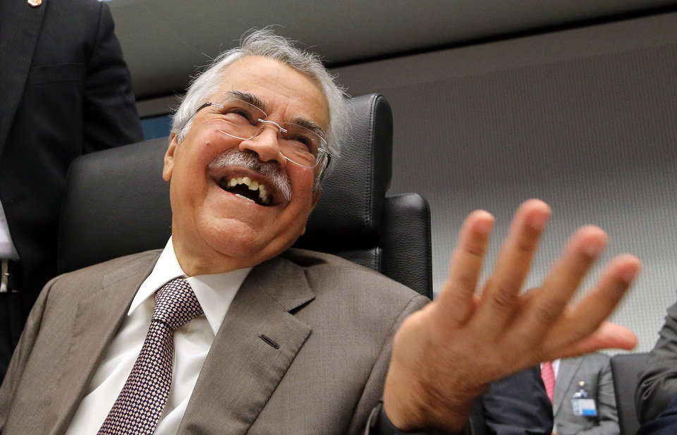 Photo - Saudi Arabia's Minister of Petroleum and Mineral Resources Ali Ibrahim Naimi gestures as he speaks to journalists prior to the start of a meeting of the Organization of the Petroleum Exporting Countries, OPEC, at their headquarters in Vienna, Austria, Wednesday, June 11, 2014. OPEC oil ministers are heading into a meeting with apparent agreement to keep unchanged their output target of 30 million barrels a day. (AP Photo/Ronald Zak)