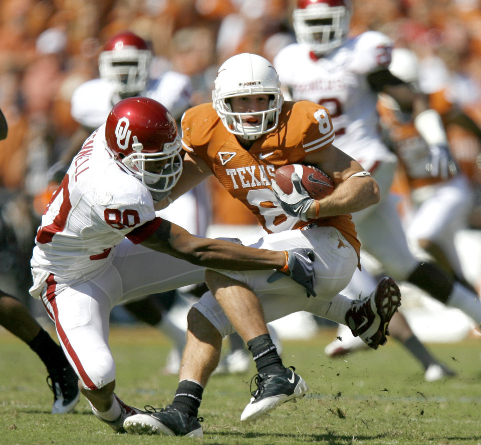 Photo - OU's Adron Tennell tries to bring down Jordan Shipley of Texas during the Red River Rivalry college football game between the University of Oklahoma Sooners (OU) and the University of Texas Longhorns (UT) at the Cotton Bowl in Dallas, Texas, Saturday, Oct. 17, 2009. Photo by Bryan Terry, The Oklahoman