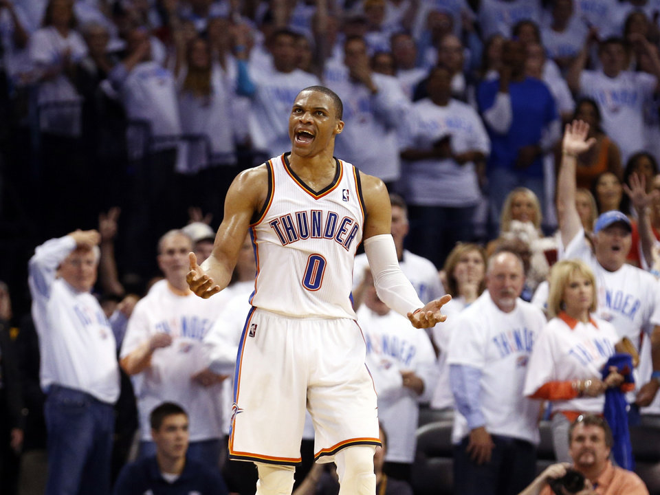 Photo - Oklahoma City's Russell Westbrook (0) celebrates after he is fouled on a 3-point shot late in the fourth quarter during Game 5 of the Western Conference semifinals in the NBA playoffs between the Oklahoma City Thunder and the Los Angeles Clippers at Chesapeake Energy Arena in Oklahoma City, Tuesday, May 13, 2014. Photo by Sarah Phipps, The Oklahoman