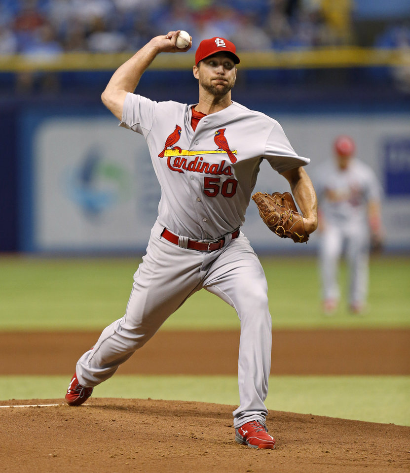 Photo - St. Louis Cardinals starting pitcher Adam Wainwright throws during the first inning of a baseball game against the Tampa Bay Rays, Tuesday, June 10, 2014, in St. Petersburg, Fla. (AP Photo/Mike Carlson)