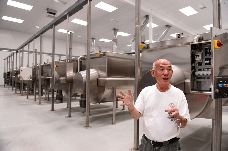 Photo - In this July 18, 2013 photo, David Tran, owner of Huy Fong Foods, maker of  Sriracha hot sauce, shows his new $15 million, 650,000 square foot factory in Irwindale, Calif. The city of Irwindale on Monday, Oct. 28, 2013 filed a lawsuit in Los Angeles Superior Court asking a judge to stop production at the Huy Fong Foods factory, claiming the chili odor emanating from the plant is a public nuisance. (AP Photo/San Gabriel Valley Tribune, Sarah Reingewirtz) MAGS OUT; NO SALES; MANDATORY CREDIT