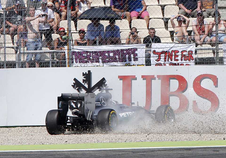 Photo - Mercedes driver Lewis Hamilton of Britain crashes during the qualifying of the German Formula One Grand Prix in Hockenheim, Germany, Saturday, July 19, 2014. The German Grand Prix will be held on Sunday.(AP Photo/Michael Probst)