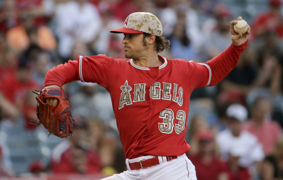 Photo - Los Angeles Angels starting pitcher C.J. Wilson throws to the Tampa Bay Rays during the first inning of a baseball game in Anaheim, Calif., Saturday, May 17, 2014. (AP Photo/Chris Carlson)