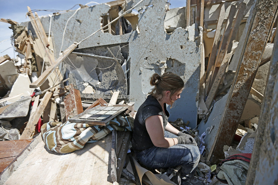 Photo - Sarah Patteson sits by the spot where she and her two children took shelter as the tornado hit her house on Kings Manor in Moore, Okla., Wednesday, May 22, 2013. A tornado damage the area on Monday, May 20, 2013. Photo by Bryan Terry, The Oklahoman