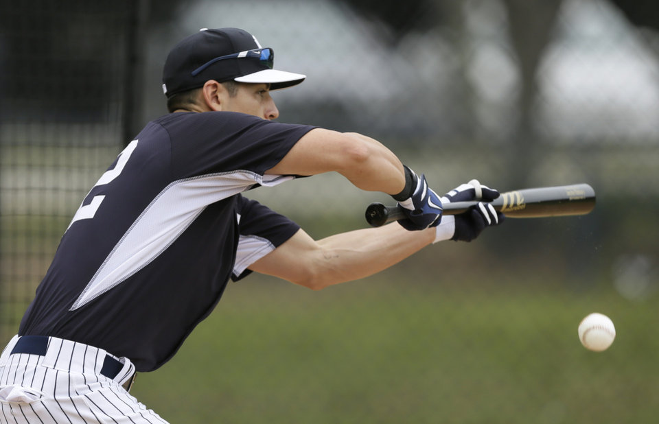 Photo - New York Yankees center fielder Jacoby Ellsbury bunts during spring training baseball practice Friday, Feb. 21, 2014, in Tampa, Fla. (AP Photo/Charlie Neibergall)