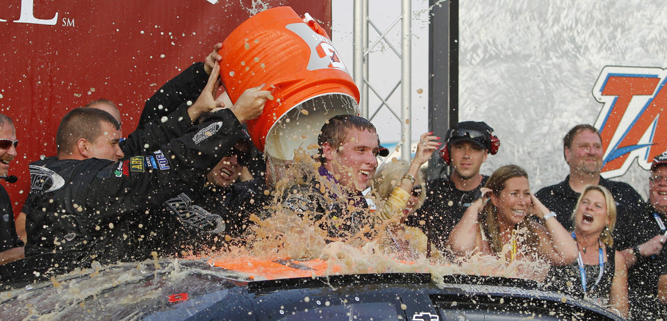 Photo -   Brandon McReynolds is doused with liquid after winning the International Motorsports Hall of Fame 250 ARCA auto race at Talladega Superspeedway in Talladega, Ala., Friday, May 4, 2012. (AP Photo/Butch Dill)