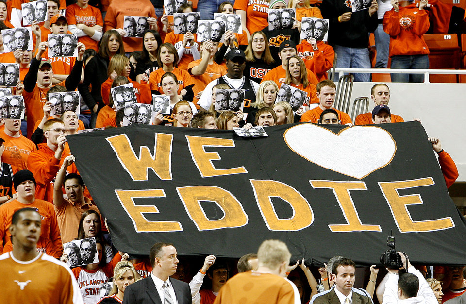 Photo - Oklahoma State University fans hold up a sign in support of Eddie Sutton in the first half of an NCAA college basketball game Sunday, Feb. 19, 2006 in Stillwater, Okla. Sutton was injured in an accident Feb. 10 and subsequently charged with drunk driving. He took the medical leave three days after the accident and admitted Wednesday that he had an alcohol problem. OSU interim coach Sean Sutton, Eddie Sutton's son, coached Oklahoma State to an 81-60 win. (AP Photo/Ty Russell)