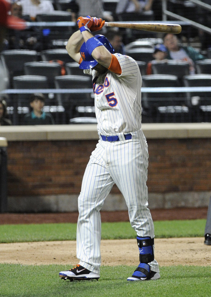 Photo - New York Mets' David Wright reacts after hitting a foul pop-up to end the baseball game during the ninth inning against the Philadelphia Phillies, Saturday, May 10, 2014, at Citi Field in New York. The Phillies defeated the Mets 5-4. (AP Photo/Bill Kostroun)
