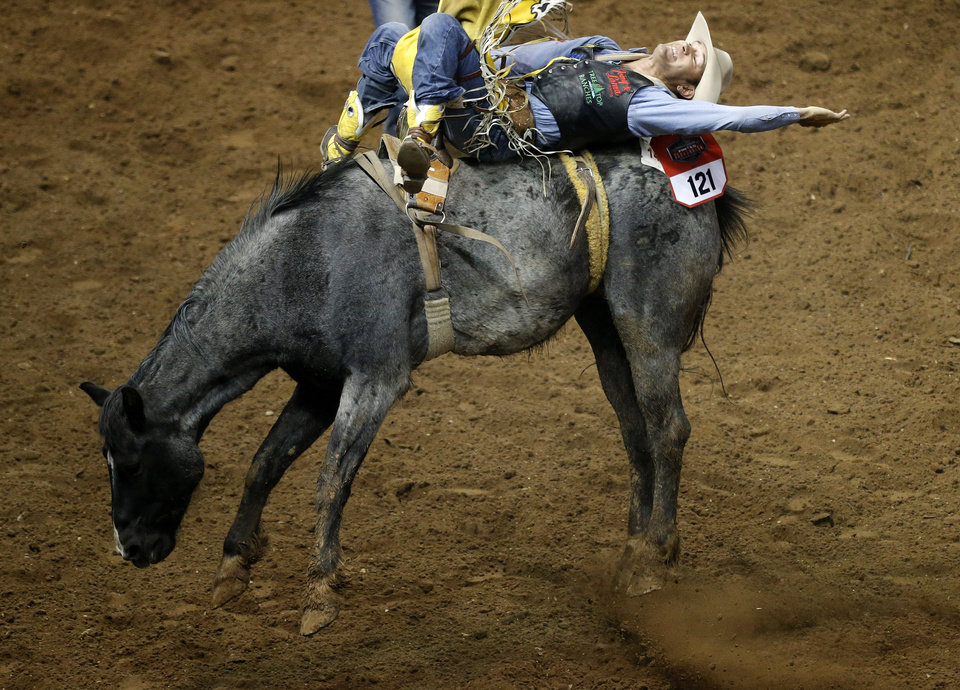 Bobby Mote of Culver, Ore., competes in bareback riding during the National Circuit Finals Rodeo at the State Fair Arena in Oklahoma City, Thursday, April 4, 2013. Photo by Bryan Terry, The Oklahoman