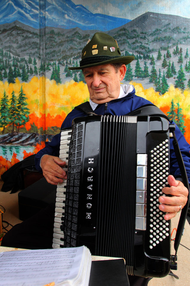 Photo - Dick Albreski of Oklahoma City plays the accordion during the 47th annual Czech Festival Saturday in Yukon. PHOTO BY HUGH SCOTT FOR THE OKLAHOMAN