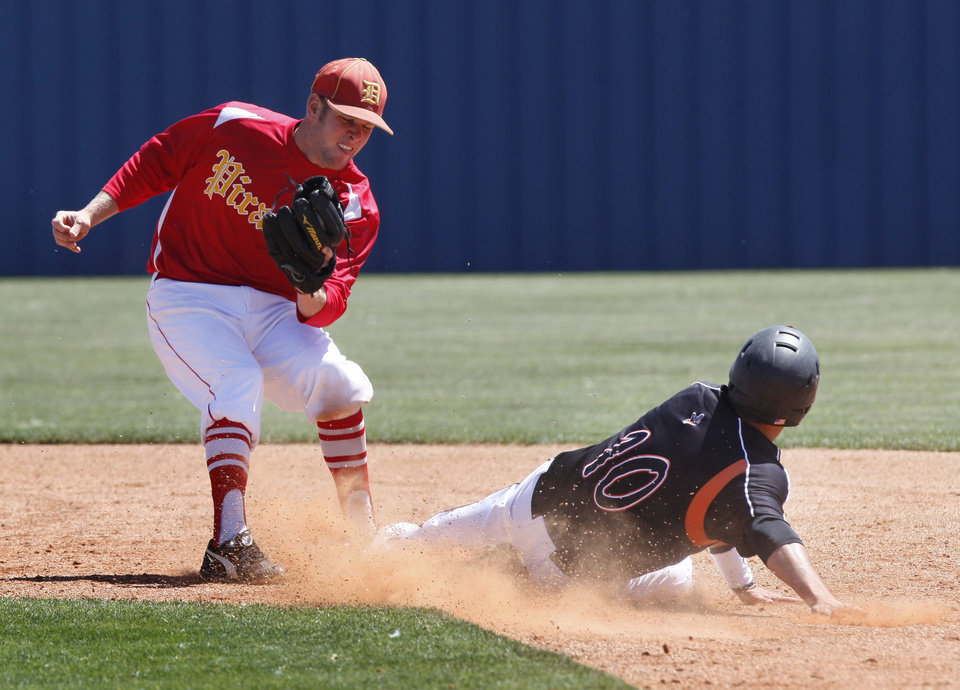 Dale second baseman Landon Coon tags Fairview's Grant Nightengale out during the class 2A state baseball game between Dale and Fairview at Dolese Park in Oklahoma City, OK, Thursday, May 10, 2012,  By Paul Hellstern, The Oklahoman