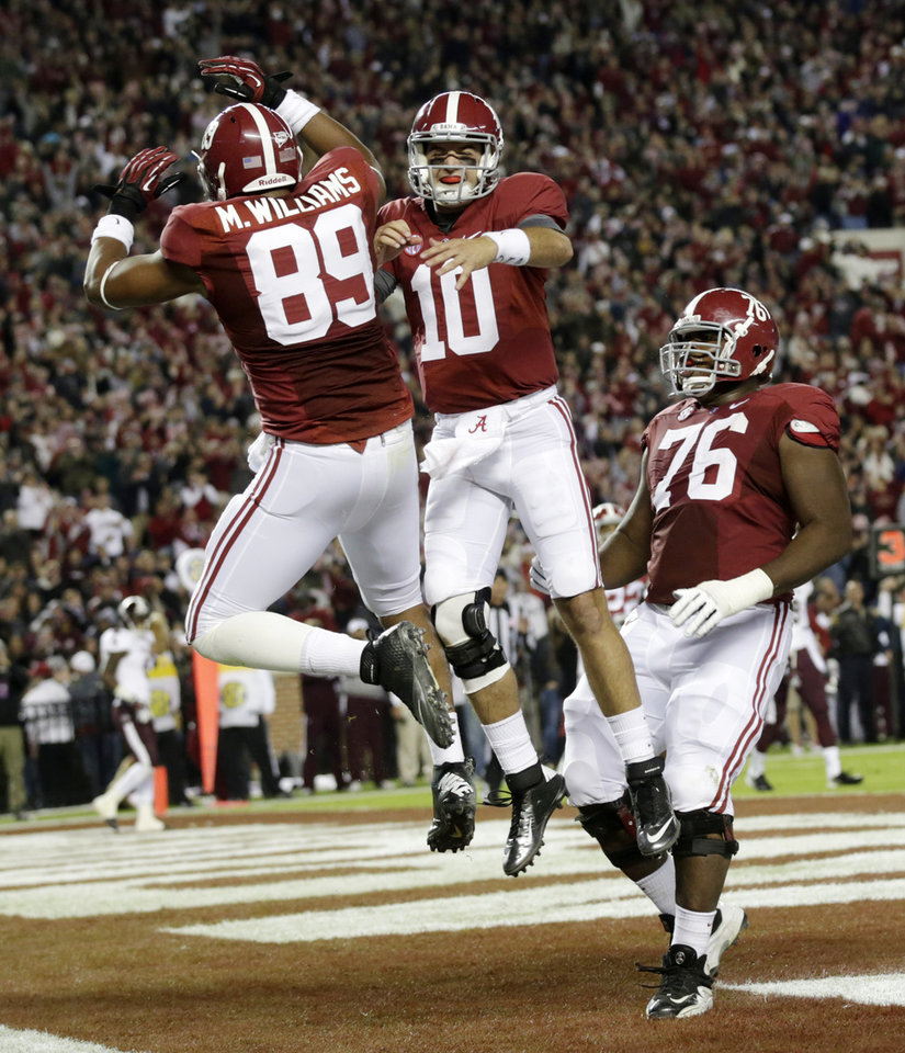 Photo -   Alabama quarterback AJ McCarron (10) reacts with tight end Michael Williams (89) after throwing him a touchdown pass during the first half of an NCAA college football game against Mississippi State at Bryant-Denny Stadium in Tuscaloosa, Ala., Saturday, Oct. 27, 2012. (AP Photo/Dave Martin)